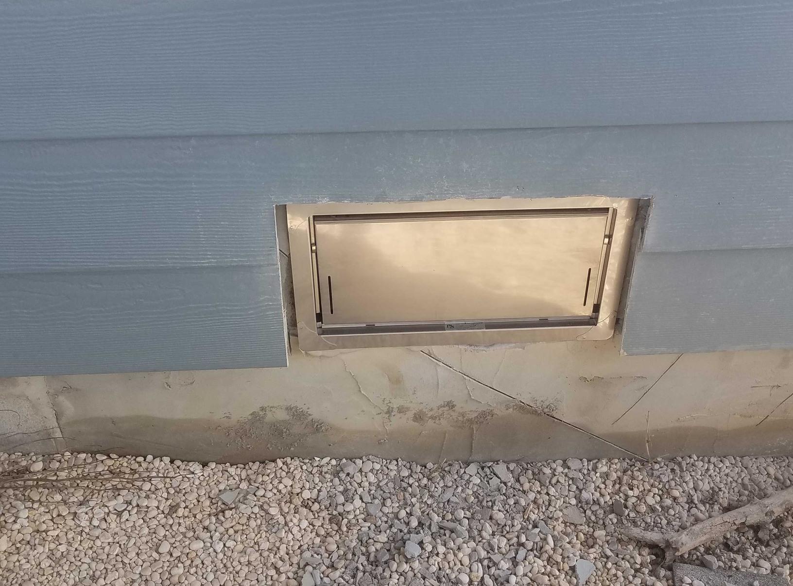 Installation of Smart Vent flood vents.