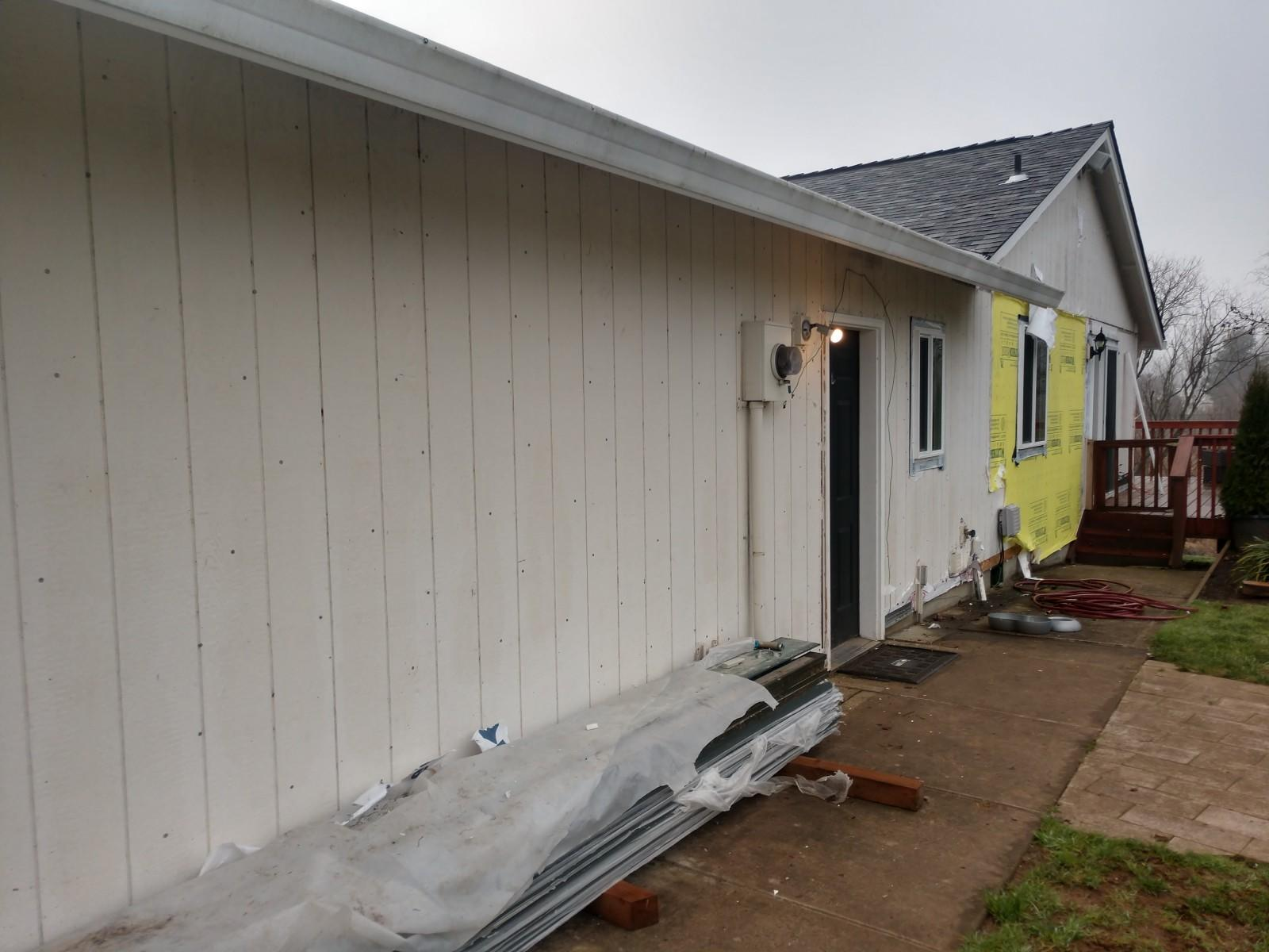 Vertical sheet siding on sides