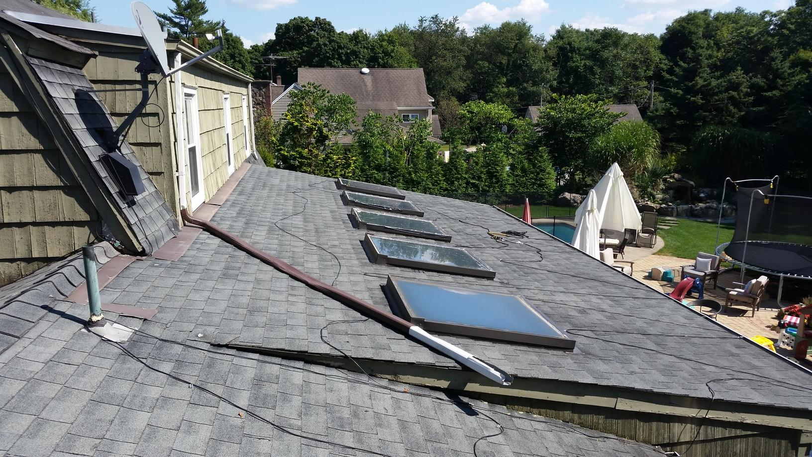 Global Home Improvement Roof Replacement Photo Album Charcoal Grey Standing Seam Metal Roof Installation On Gambrel Style Roof In Franklin Lakes Nj