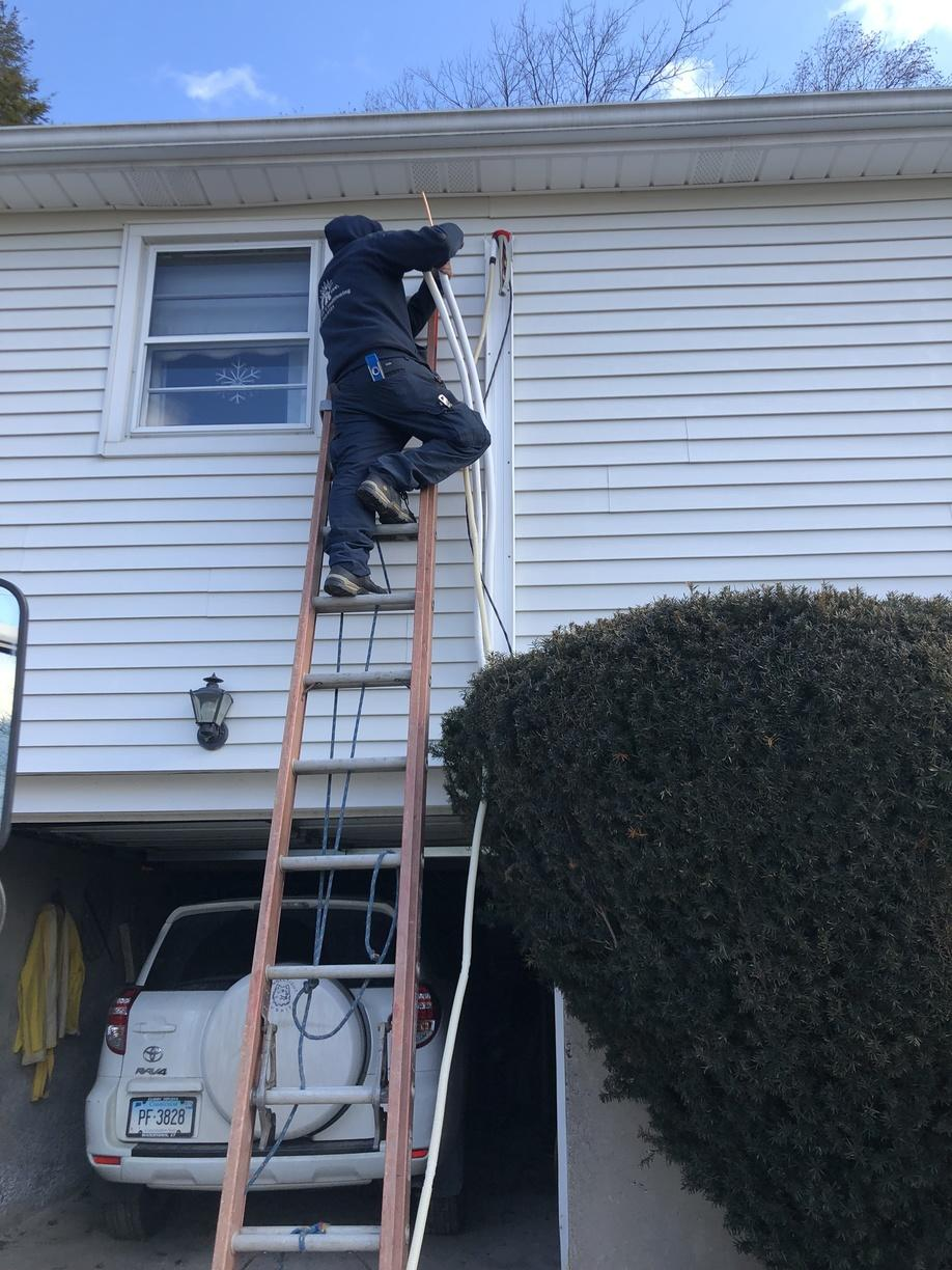 Line hide and wire installation during a ductless installation in Watertown