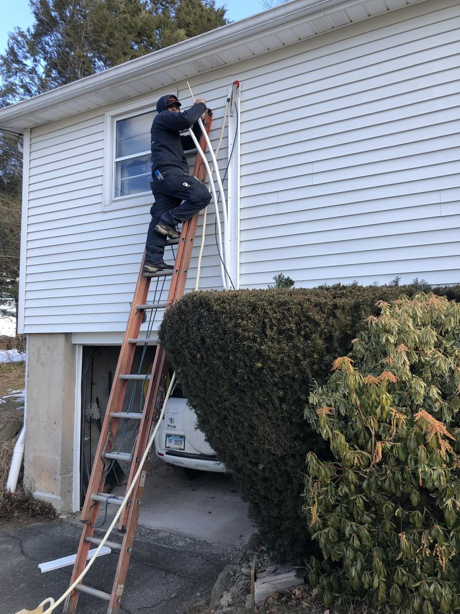 Working hard during a ductless installation in Watertown!