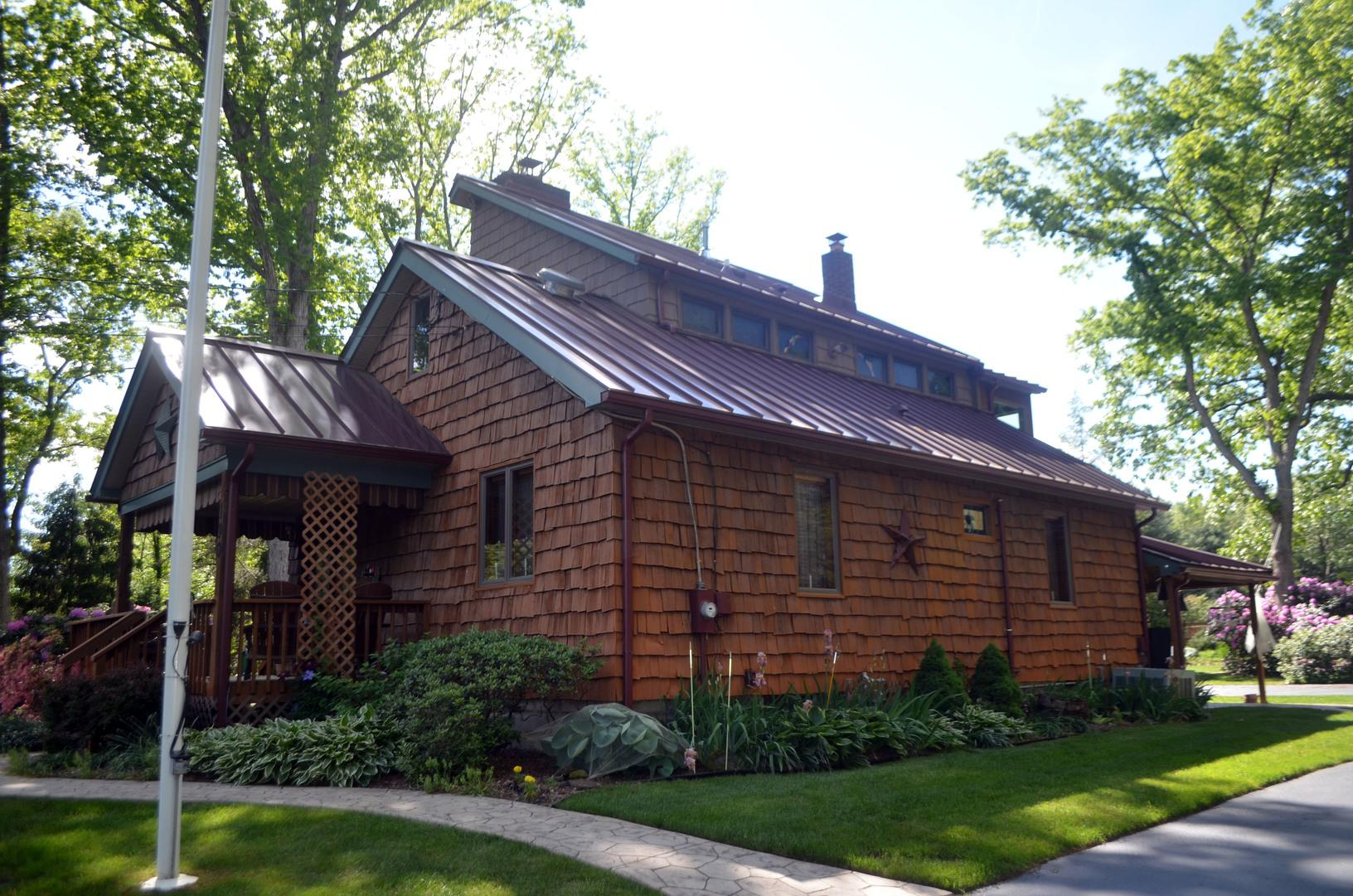 Pairing Burgundy Metal Roof with Wood Siding