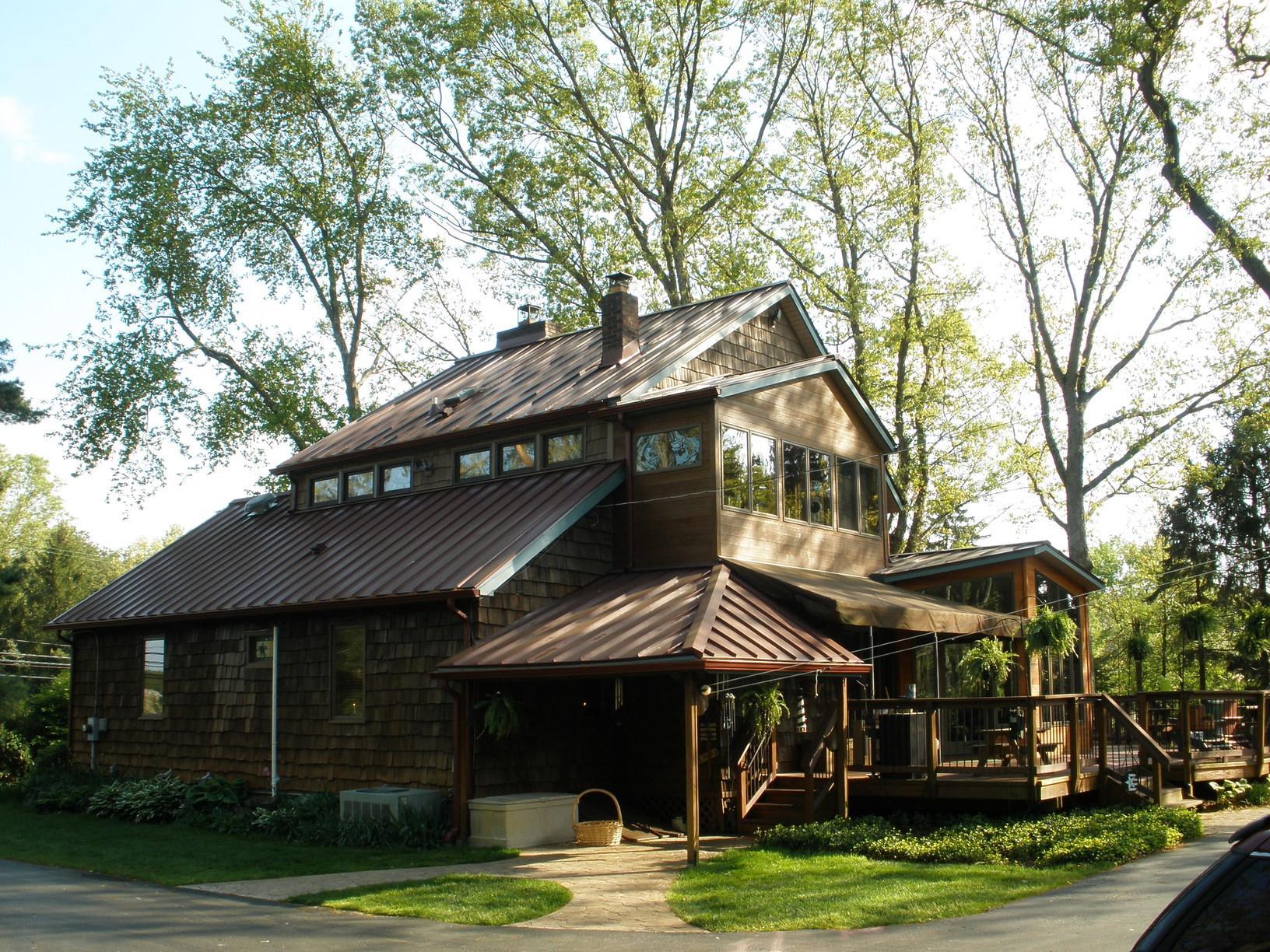 Burgundy Standing Seam Metal Roof Install on Rustic Home in Jackson, NJ