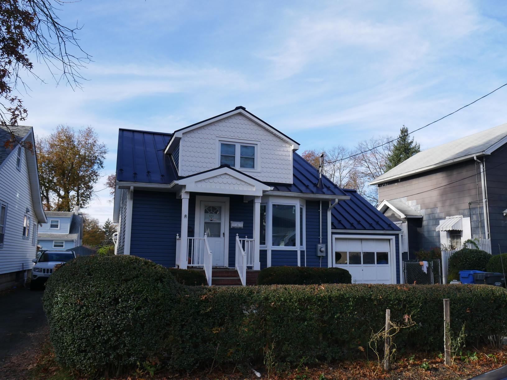 Charcoal Grey Standing Seam Metal Roof On Cape Cod Style Home in NJ