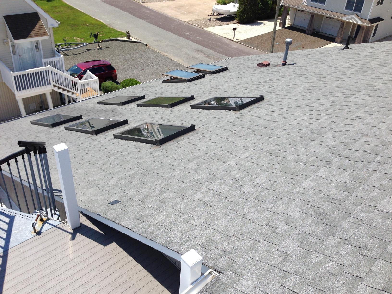 Replacing Storm-Damaged Asphalt Shingles with Several Skylights in NJ