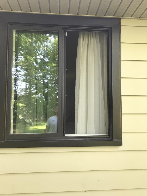 Marvin Infinity Slider Window with Bronze Exterior