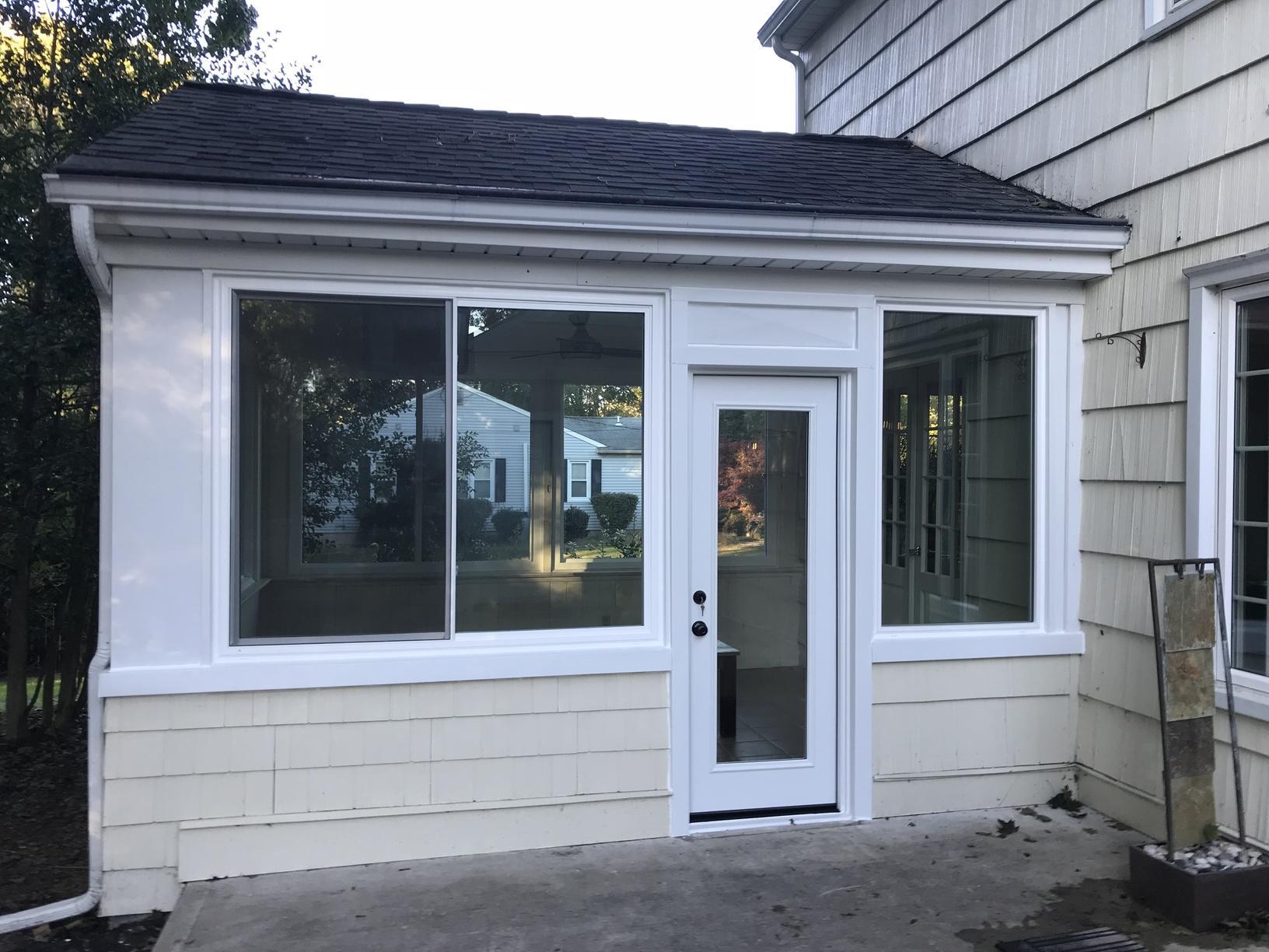 Installing GlobalTech Vinyl Windows on Sunroom in NJ