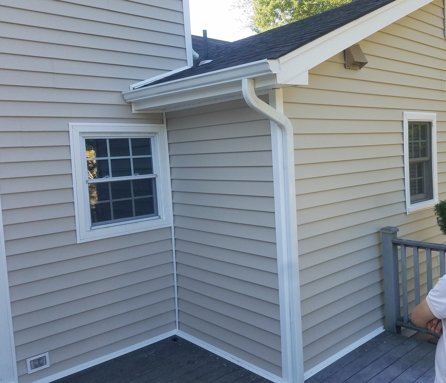 Vinyl Siding with Antique Parchment Finish and White Trim Install in NJ