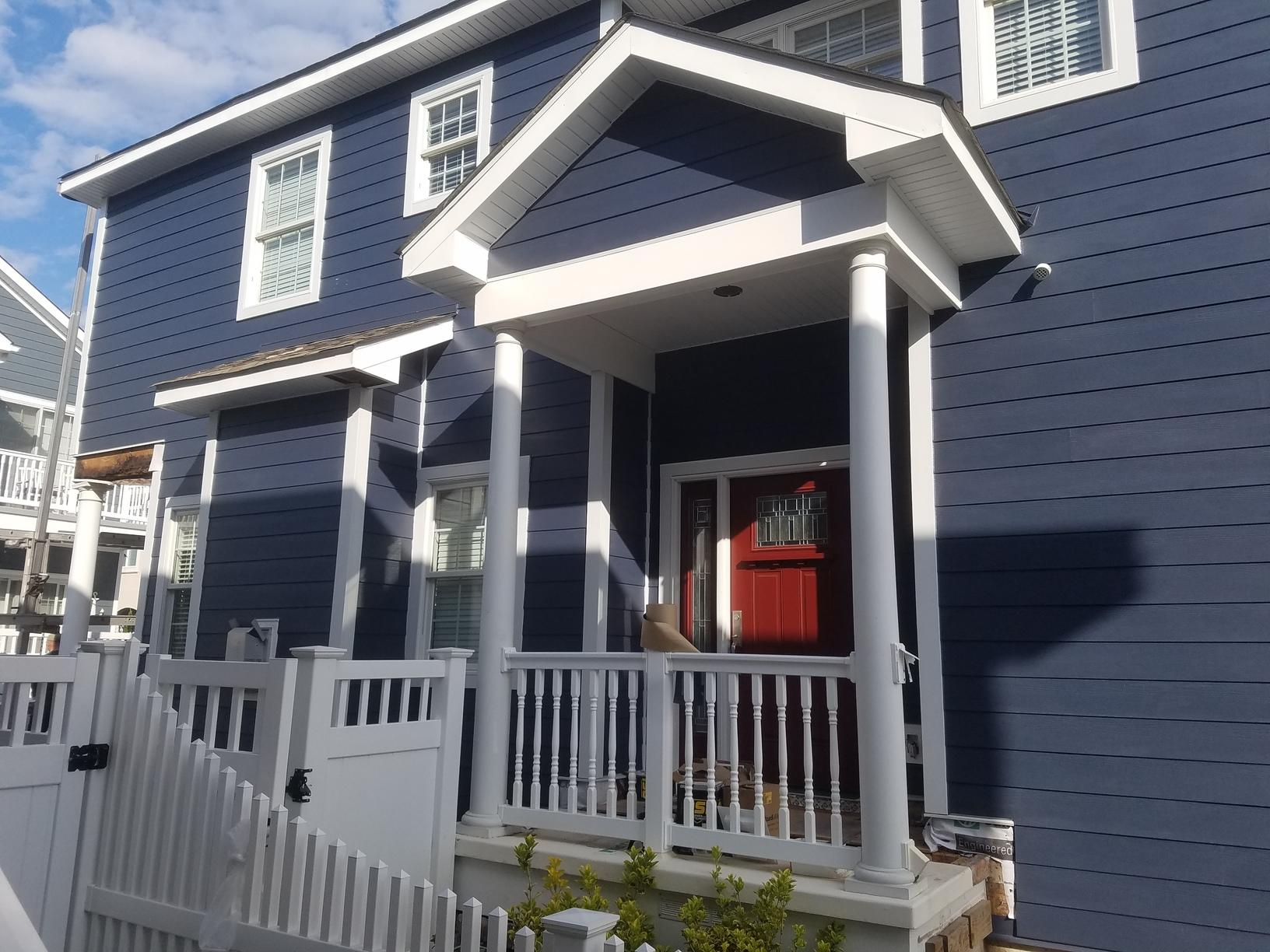 Evening Blue Hardie Siding with White Trim on Beach Home in Wildwood Crest, NJ