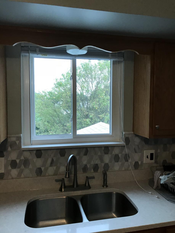 Installing Vinyl Slider Window in Kitchen of Aston, PA Home