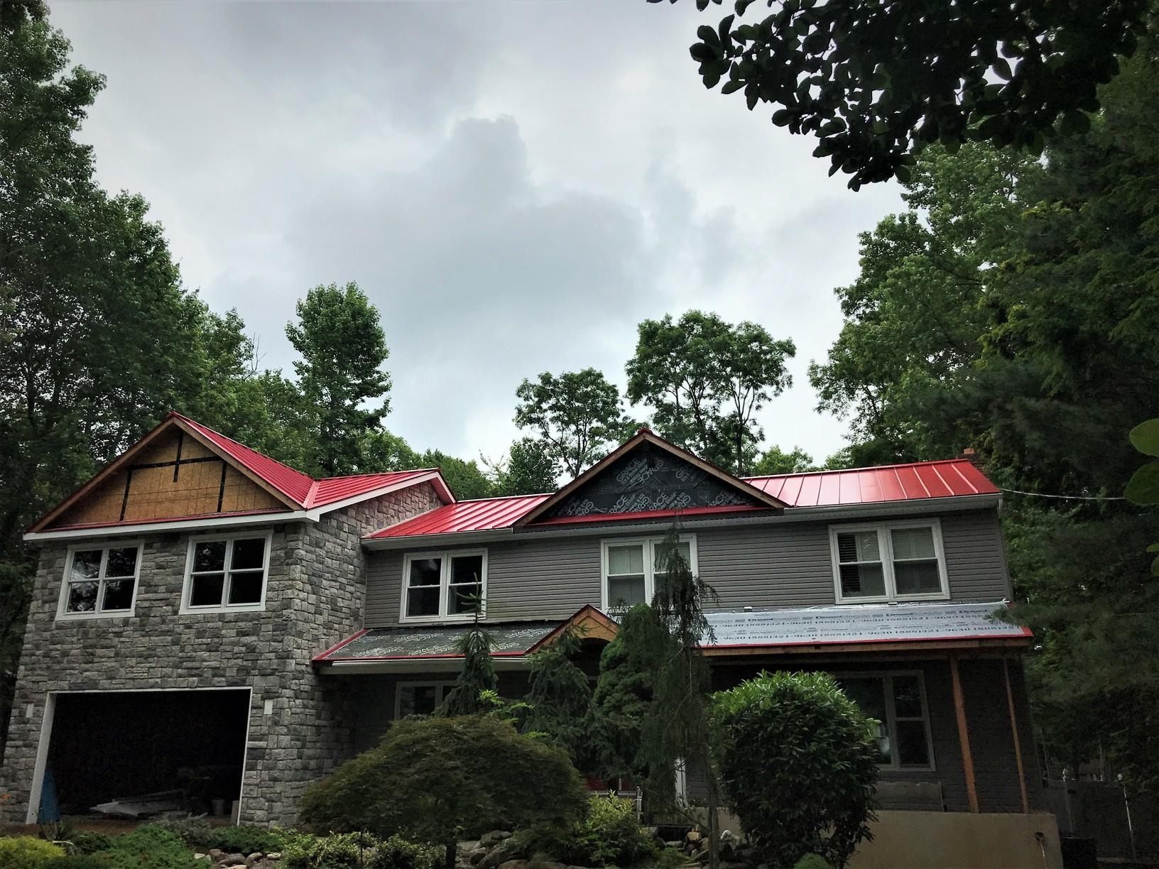 Deep Red Standing Seam Metal Roof Installation in Manalapan, NJ