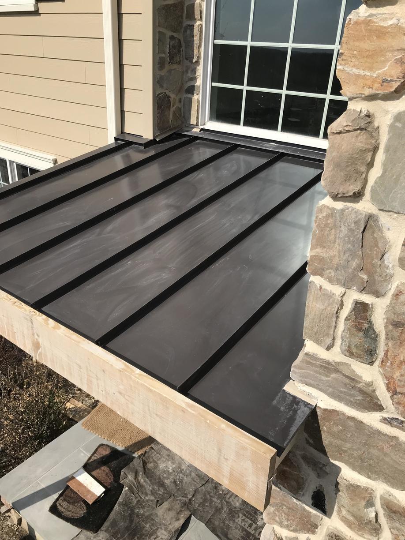 Standing Seam Metal Roof Over Entryway