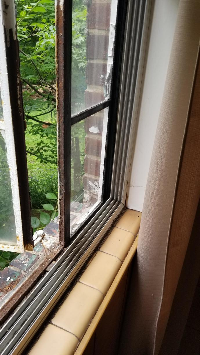 Interior of Metal Windows to be Replaced