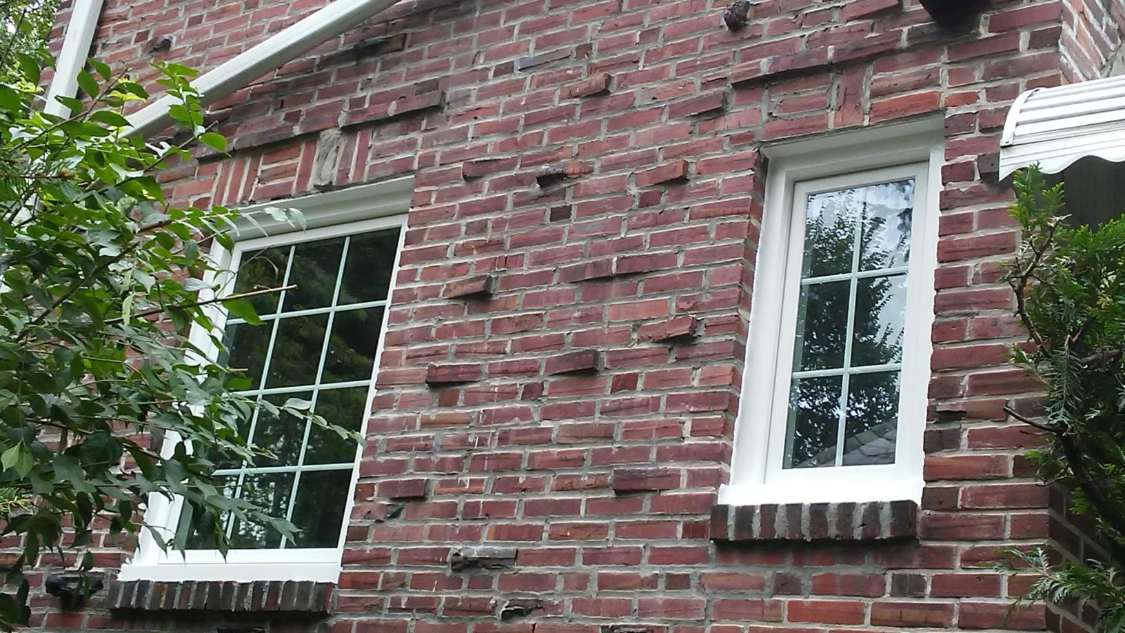 Marvin Infinity Windows with White Finish Installed on Brick Siding