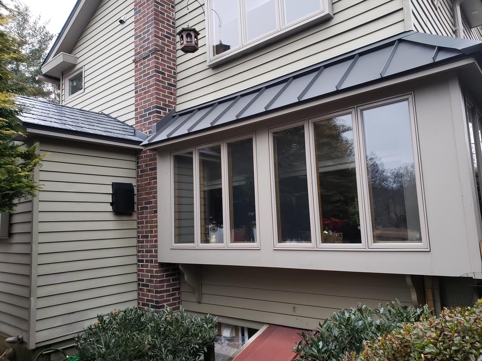 Standing Seam Metal Roof Over Windows