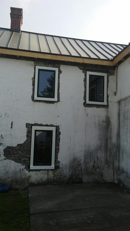 White Infinity Windows and Granite Standing Seam Metal Roof