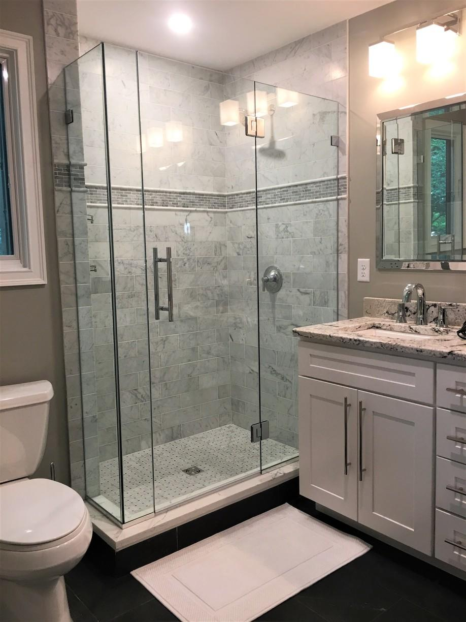 Bathroom Featuring Tile Accents and Glass Shower