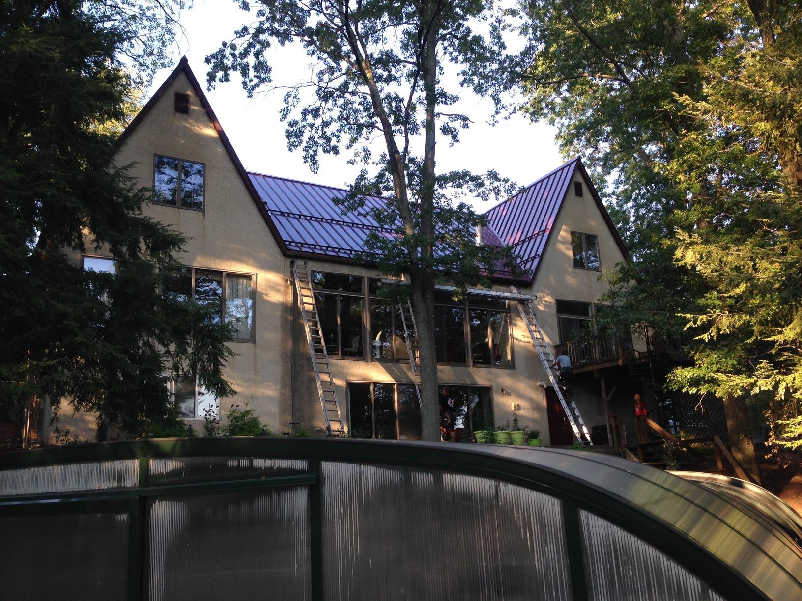 Burgundy Metal Roof Over Creme Siding