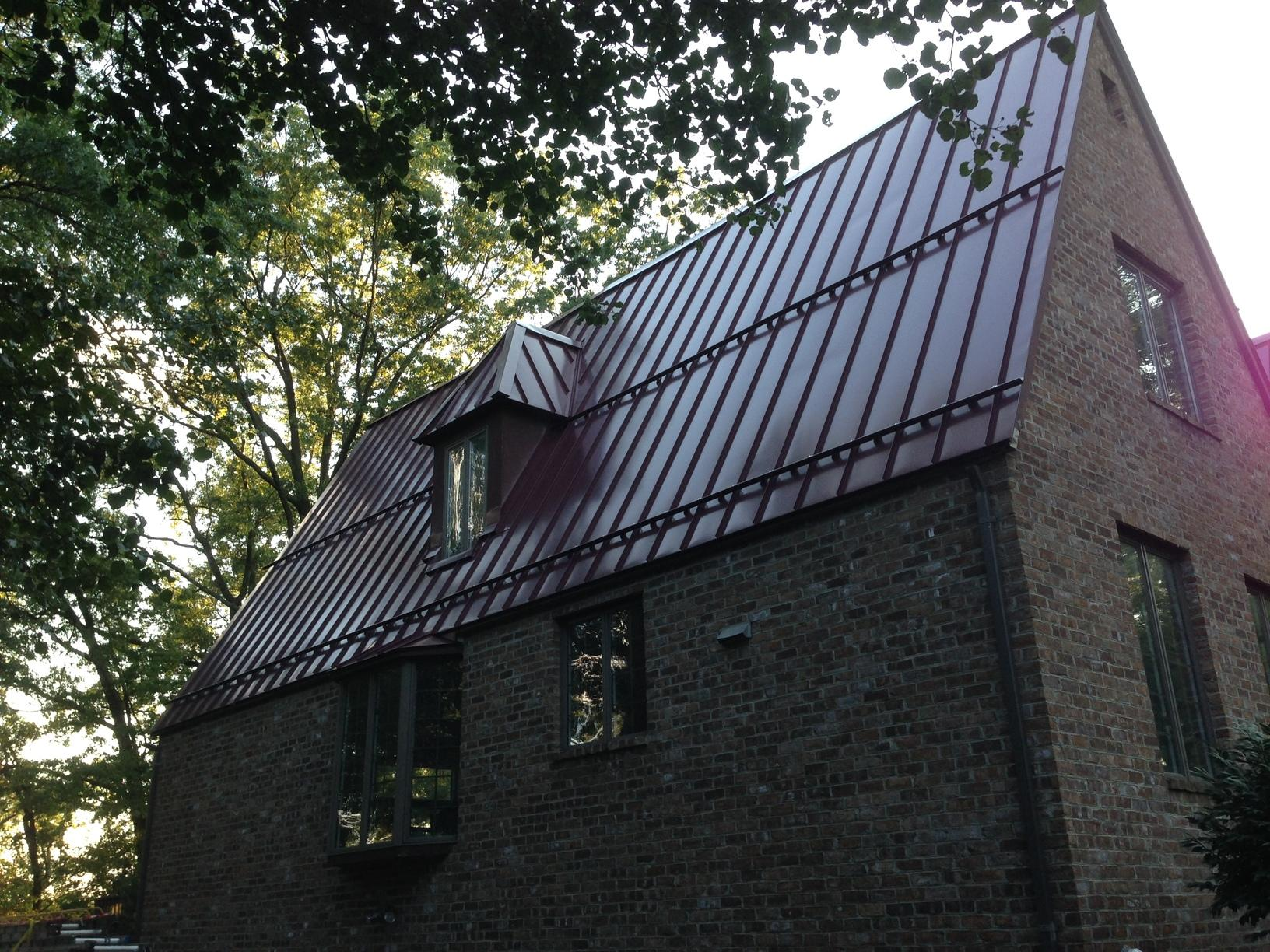 Standing Seam Metal Roof Over High Sloped Roof and Snow Guards