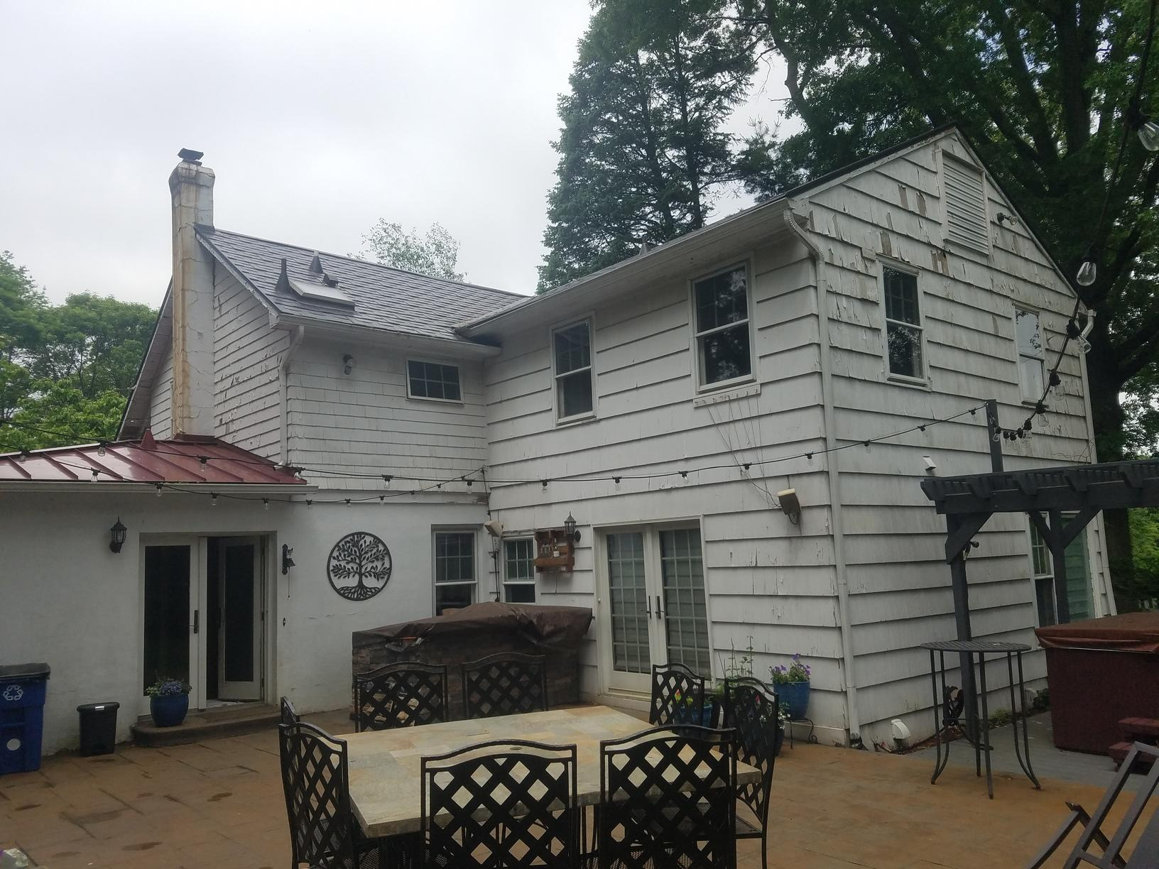 Replacing Chipping Wood Siding in Freehold, NJ
