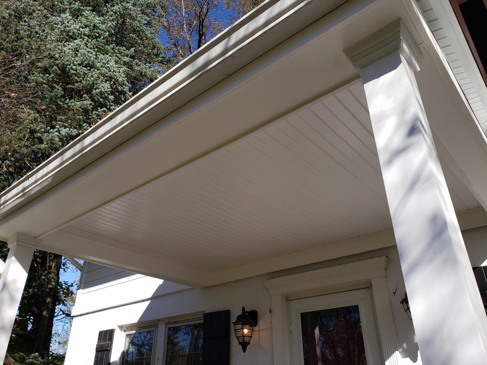 White Soffits and Square Beams Installed on Home's Portico