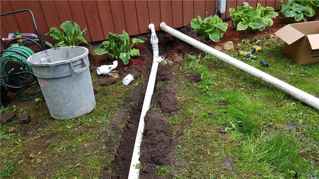 Discharge line installed outside the basement