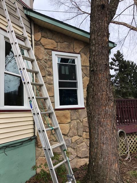 White Vinyl Windows with Stone Siding