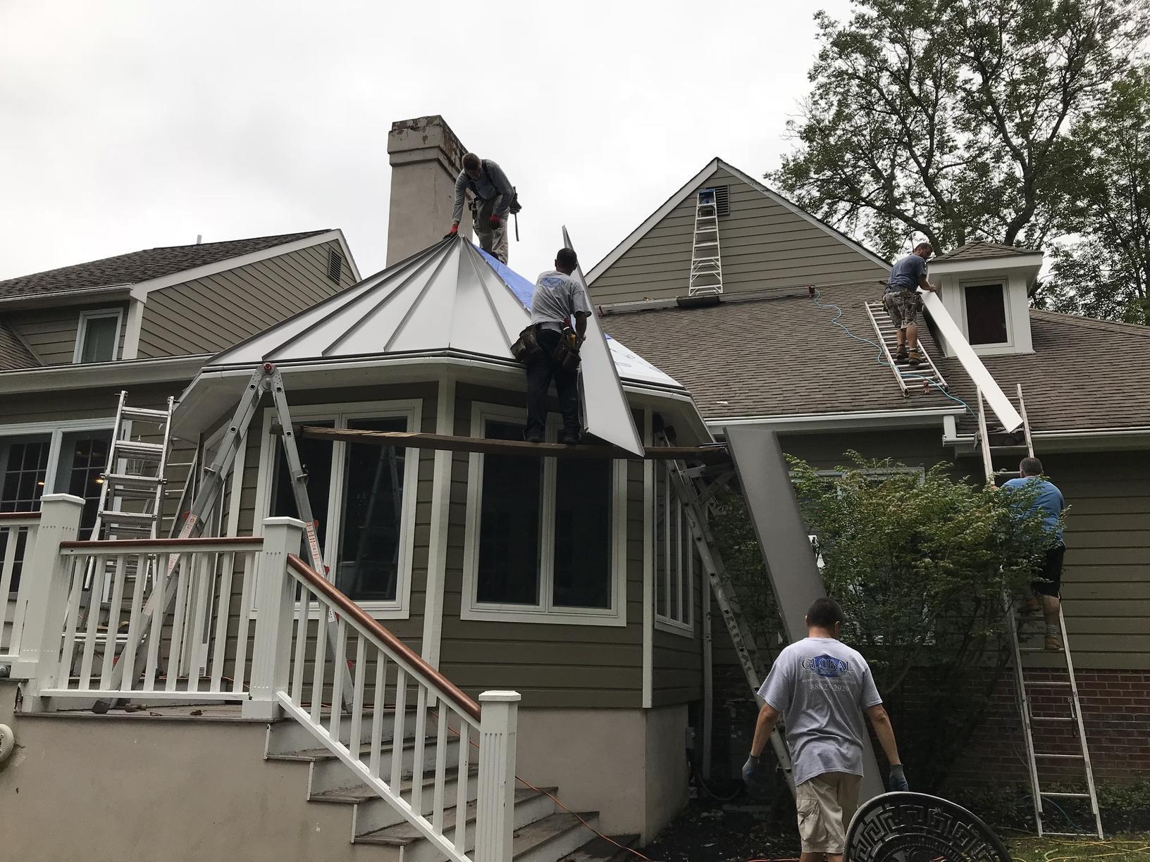 Installing Slate Grey Standing Seam Metal Roof in PA