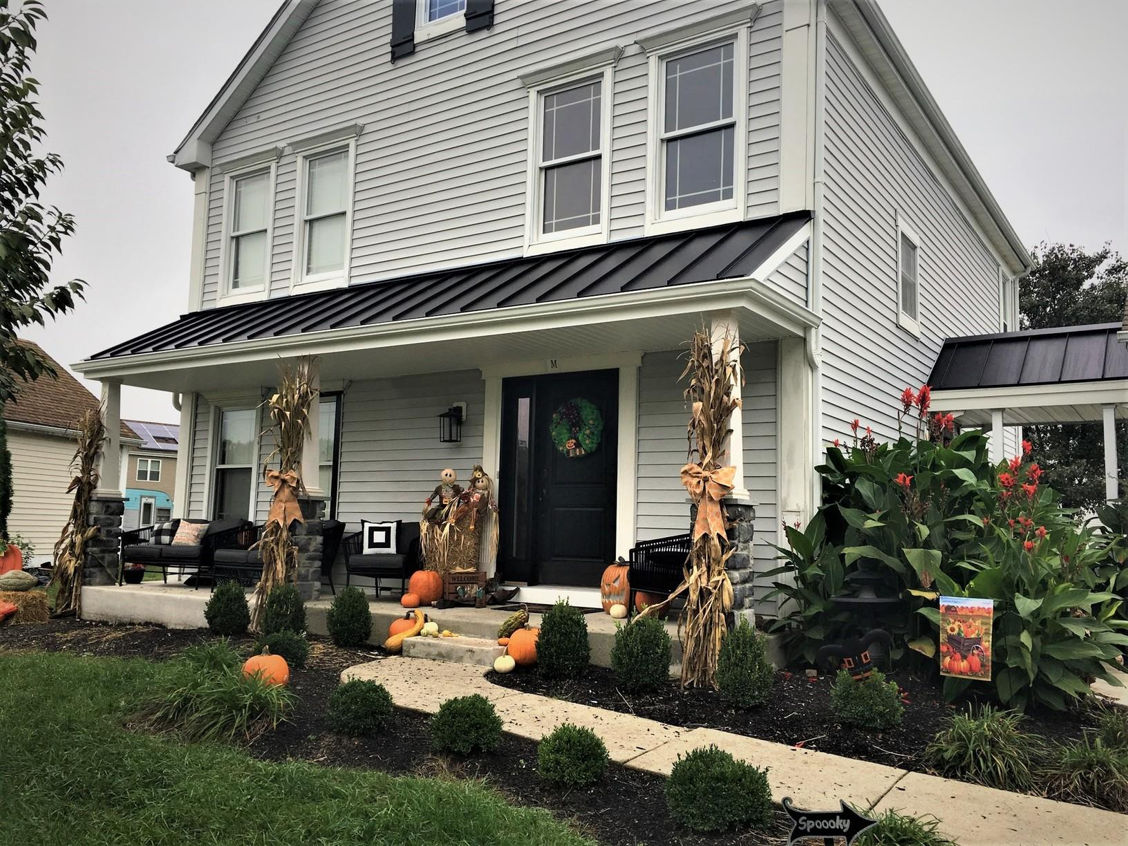 Extending Front Porch, Installing Matte Black Standing Seam Metal Roof, and Replacing Pillars with Stone Face on Bottom in Clayton, NJ