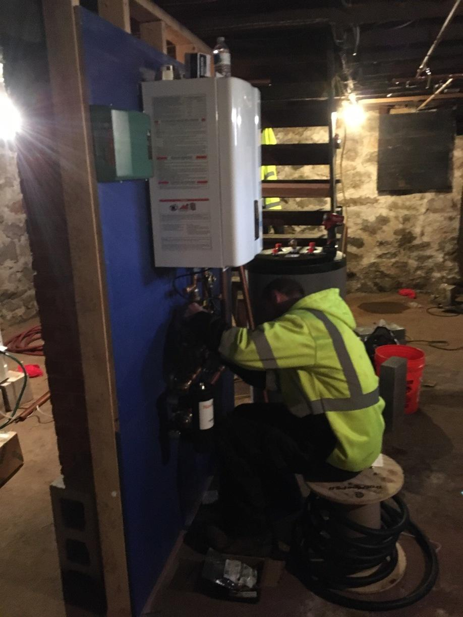 One of our installers during a Navien Combi boiler installation for our customer in Branford!