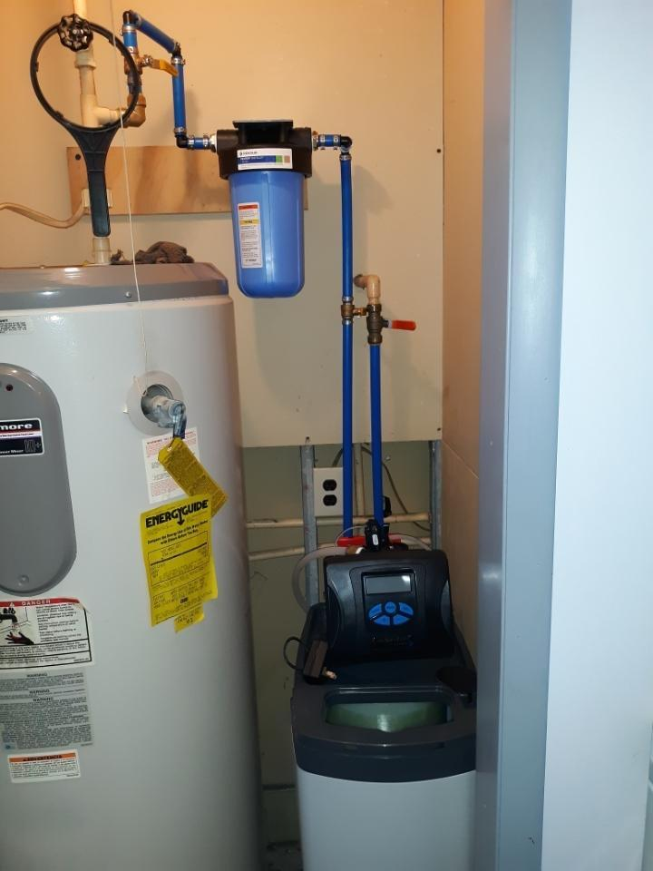 Cabinet water softener replacement