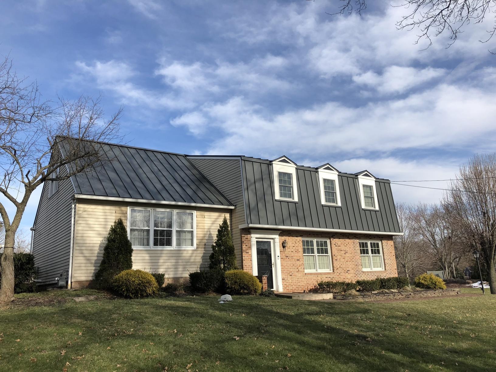 Grey Standing Seam Metal Roof on Steep-Sloped Roof