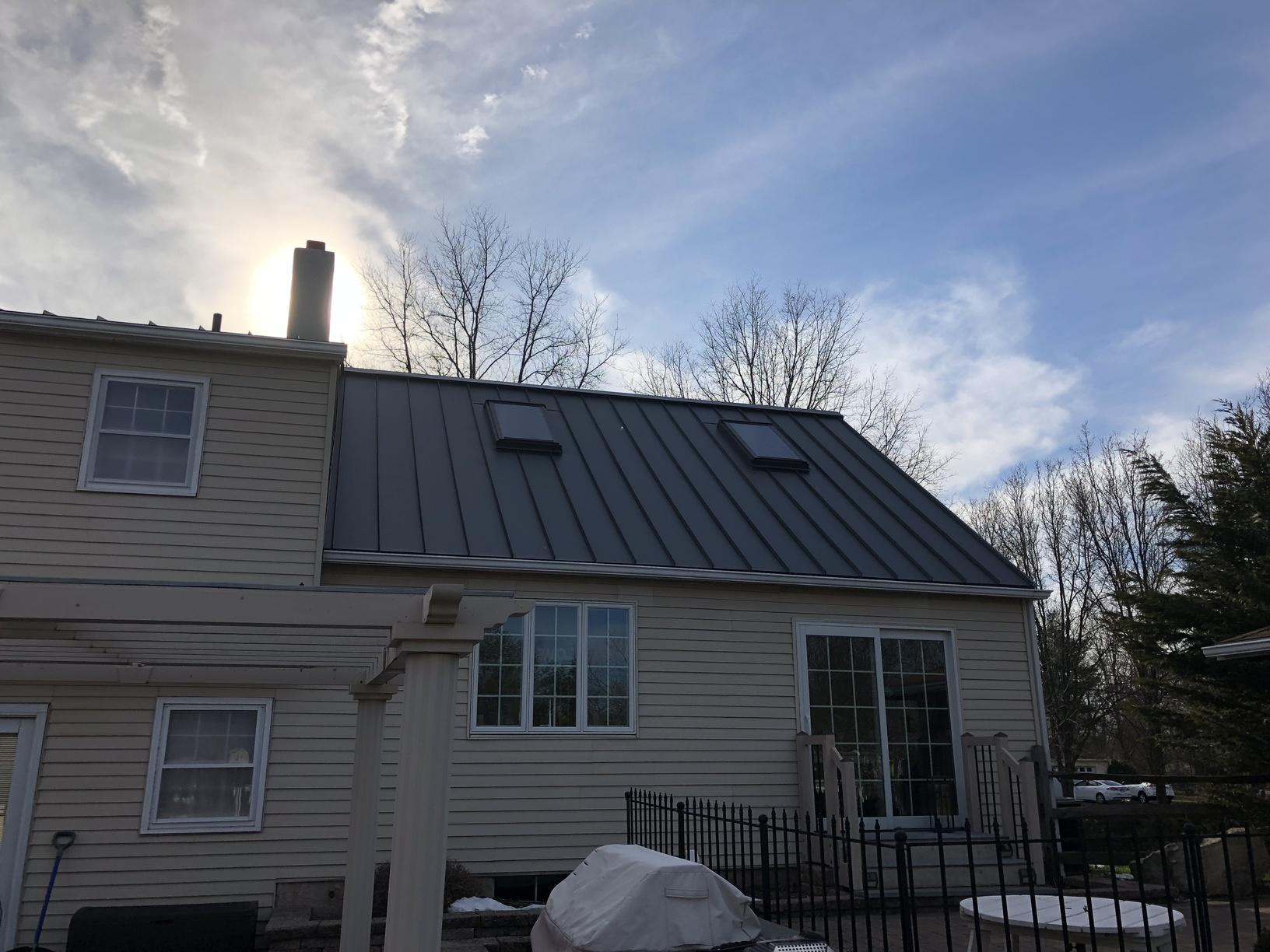 Standing Seam Metal Roof Install with Existing Skylights