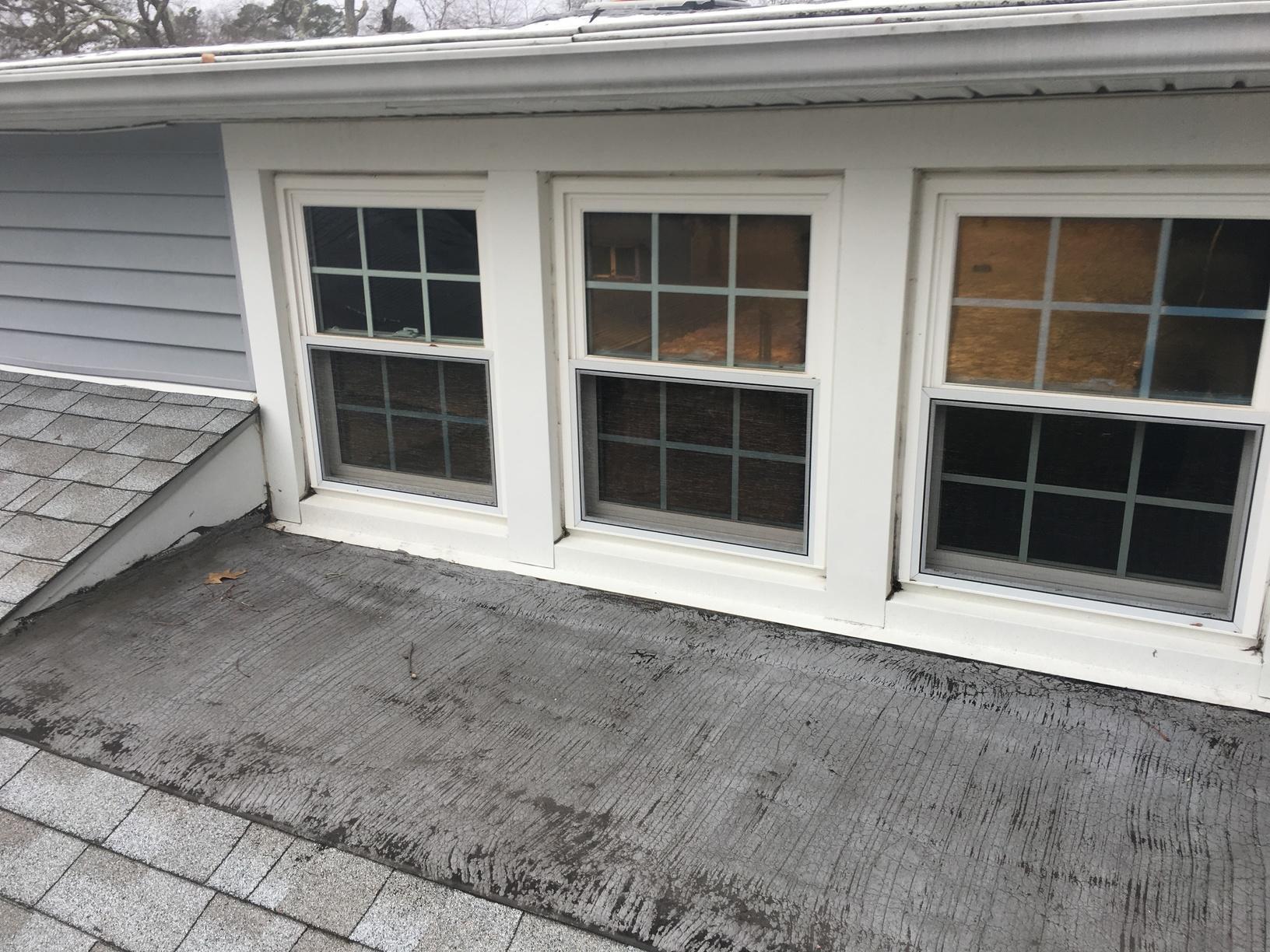 Replacing Leaky Asphalt Shingles Around Windows