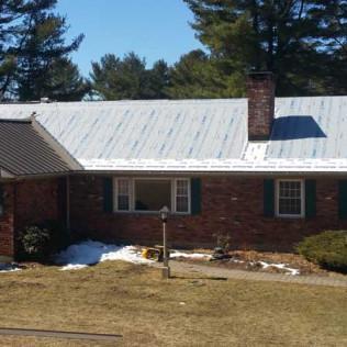 A New Metal Roof Installation in Progress in Richmond, MA