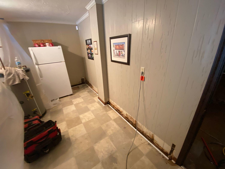 Water Damaged Basement Floor