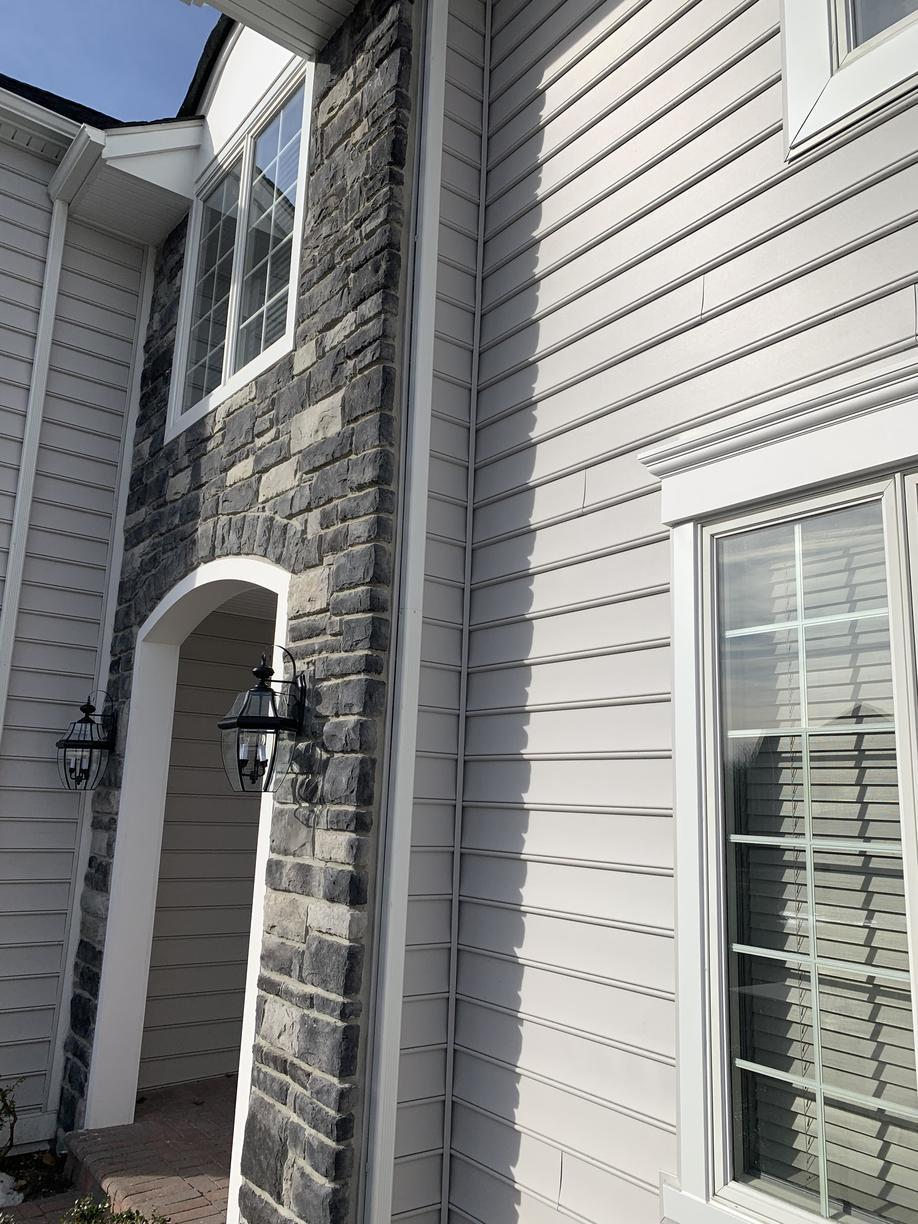Revamping Front of Home with Vinyl and Stone