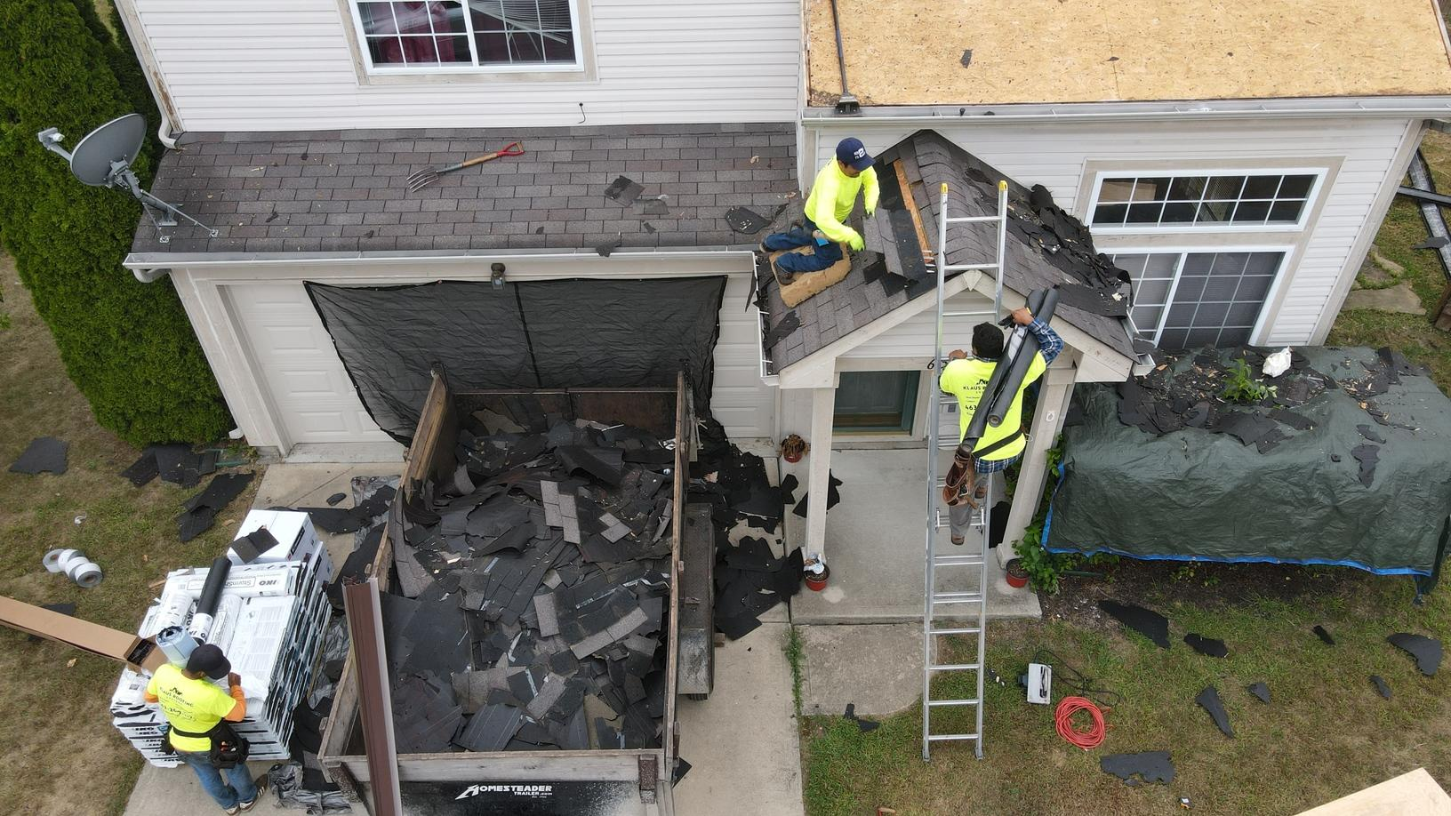 Klaus Roofing Crew Finishing Roof Tear Off