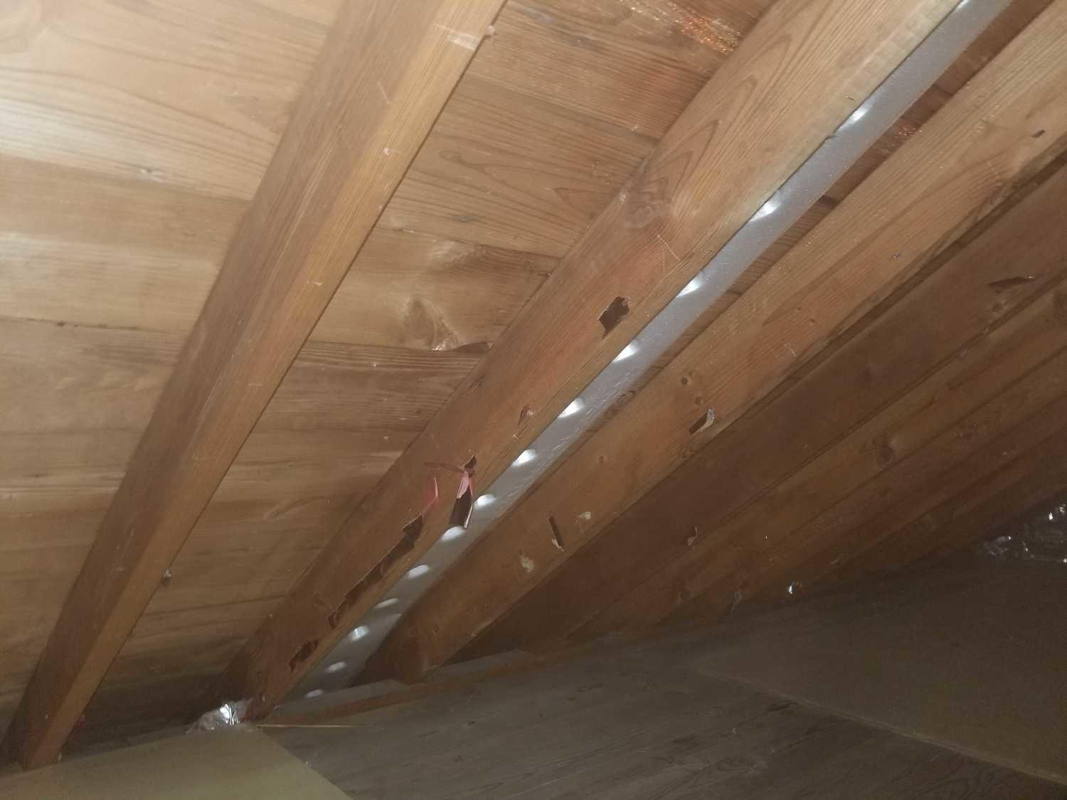 Attic boards after application of stain remover