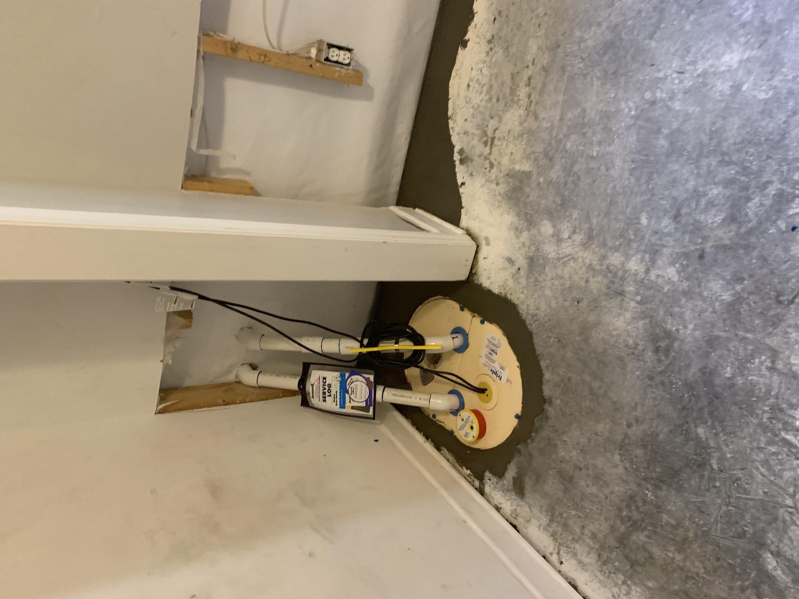 Sump Pump in Basement Corner
