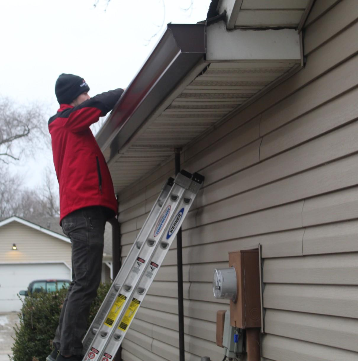 Gutter Guard System Being Installed