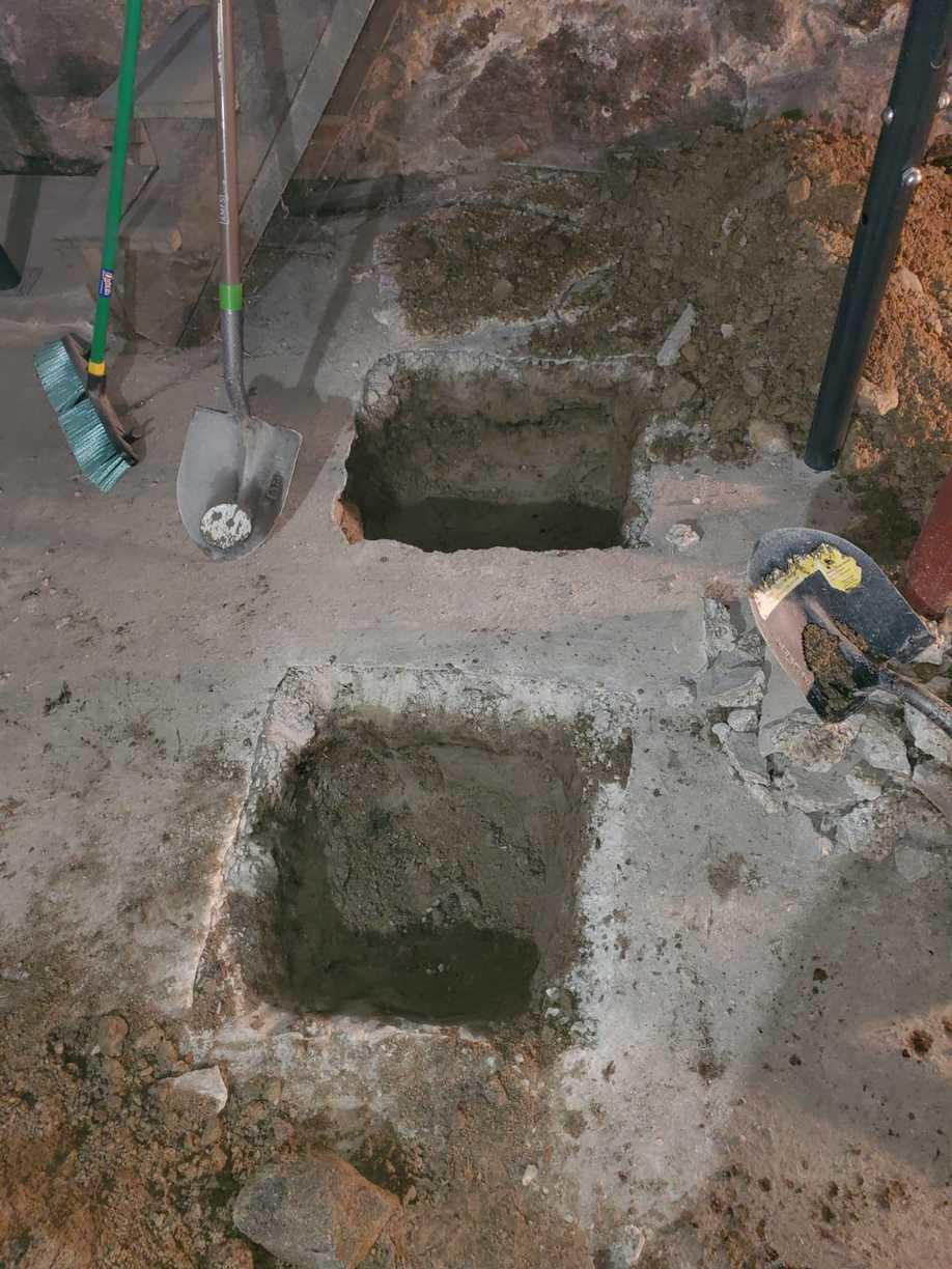 Holes are Dug for the Lally Columns to be Set In Place