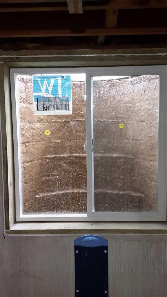 Window WellDuct captures water from wall crack and sends to sump pump