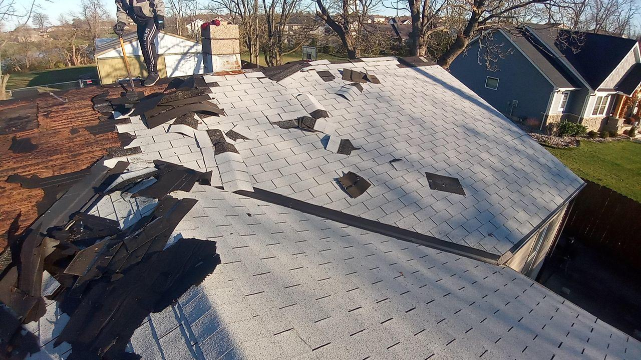 Shingles Being Stripped Off of Roof