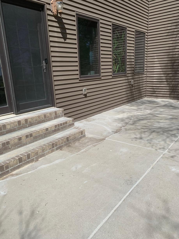 Back patio concrete now leveled