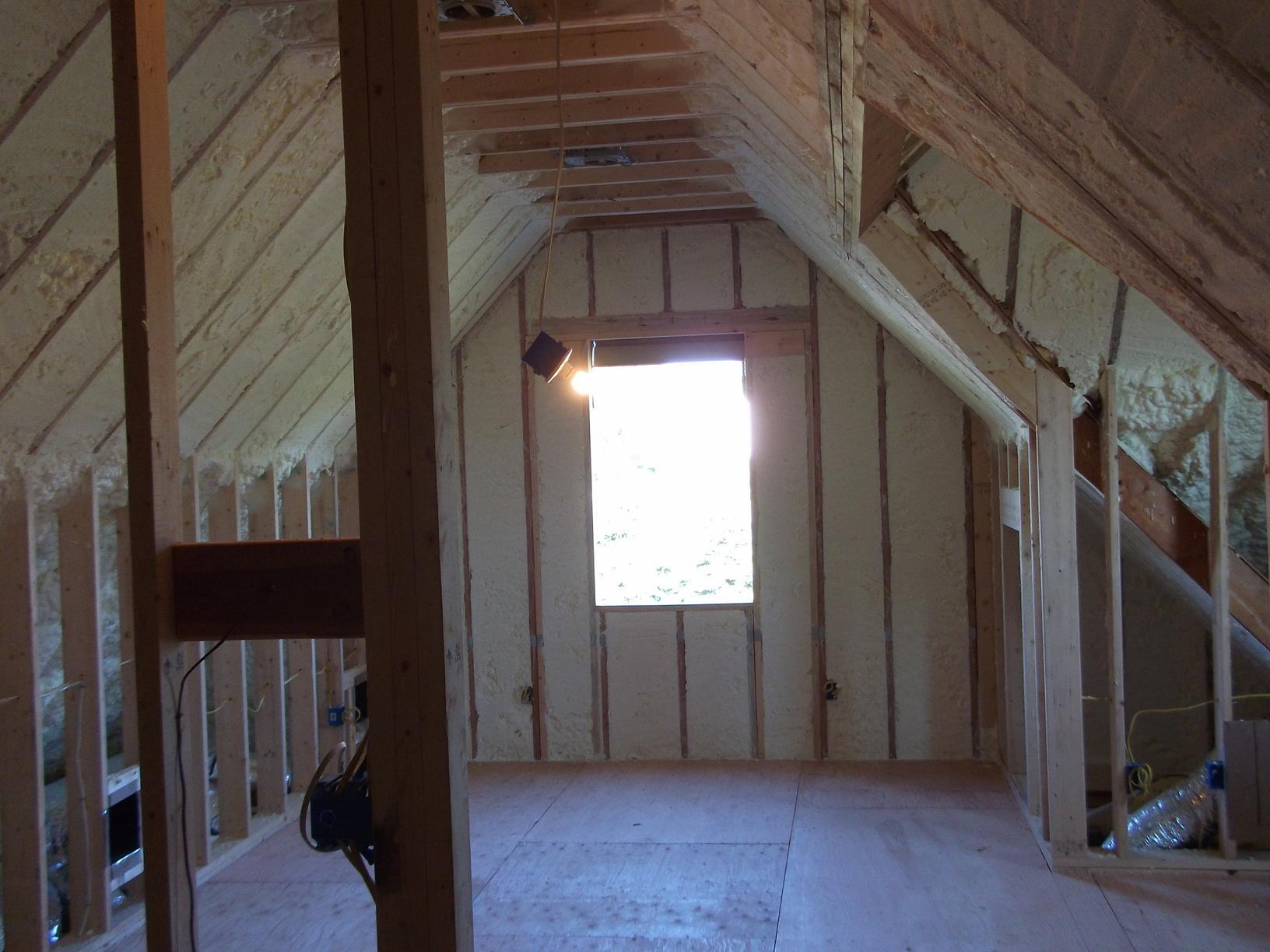 Spray foam insulation in attic roof slopes