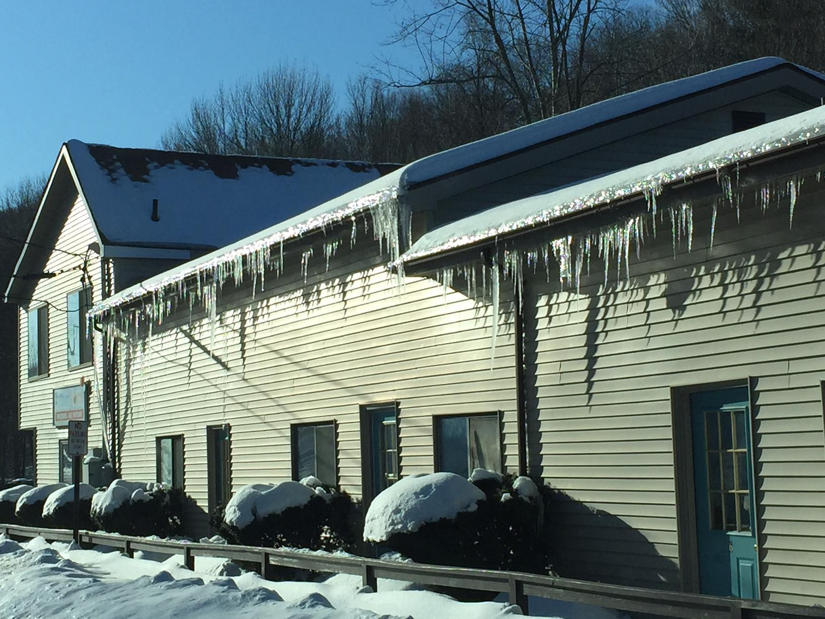 Sun's heat melting snow on roof