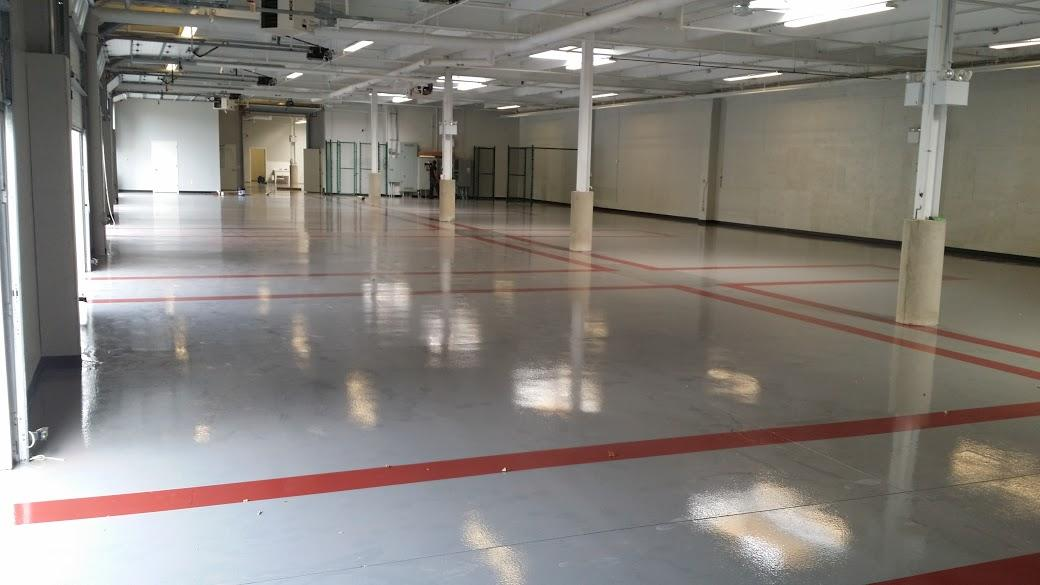 Red lines installed on the floor to outline the each bay