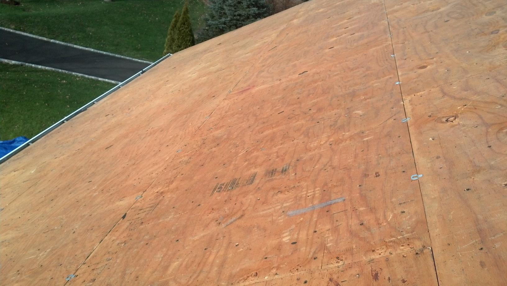 Inspecting the Sheathing of a Monroe, CT Roof