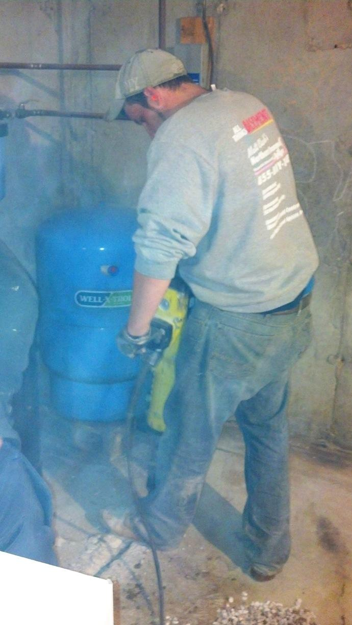 Concrete removal before drainage system installation